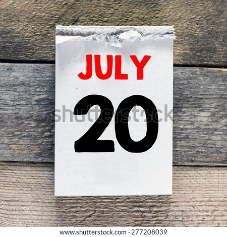 Calendar with 20 july on wooden background - stock photo