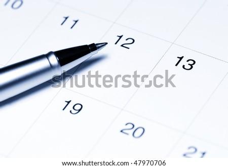 Calendar with pen - stock photo