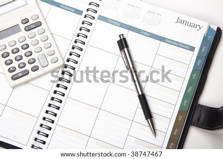 Calendar With Pen And Calculator - stock photo