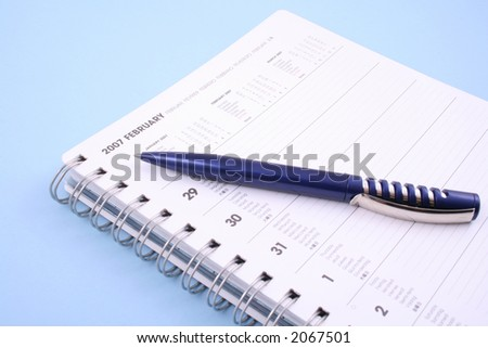 calendar with pen - February 2007 isolated on blue - stock photo