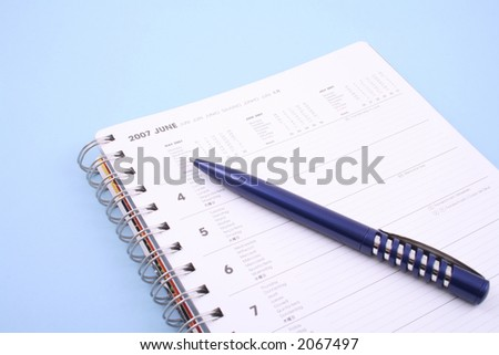 calendar with pen - June 2007 isolated on blue - stock photo