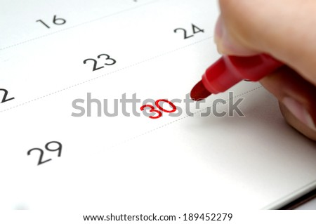 Calendar with red date at 30 and red pen.  - stock photo