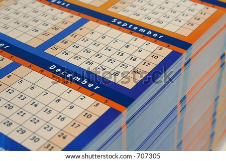 calendars stacked - stock photo