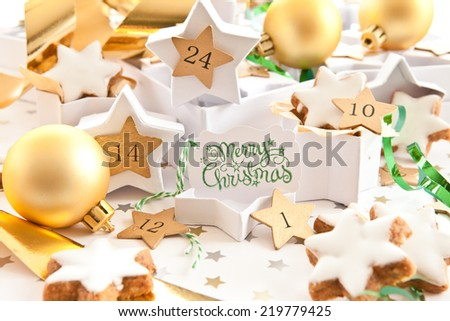Calender for advent with gift boxes and christmas cinnamon cookies - stock photo