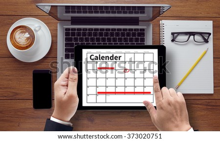 Calender Planner Organization Management Remind Concept, on tablet pc screen held by businessman hands - concept, top view computer, phone ,coffee, Warm tone - stock photo