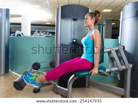 Calf extension woman at gym exercise machine workout indoor - stock photo