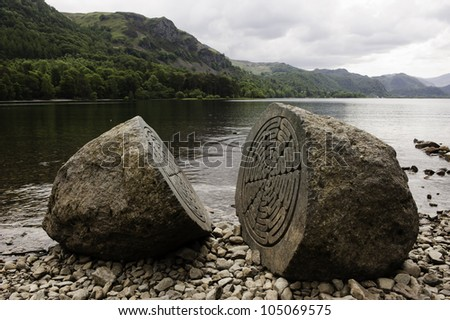 CALFCLOSE BAY, UK - JUN 10: the Centenary Stone in Calfclose Bay, Lake District, UK on June 10, 2012. The stone was carved by Peter Randall-Page to commemorate the National Trust's centenary in 1995. - stock photo