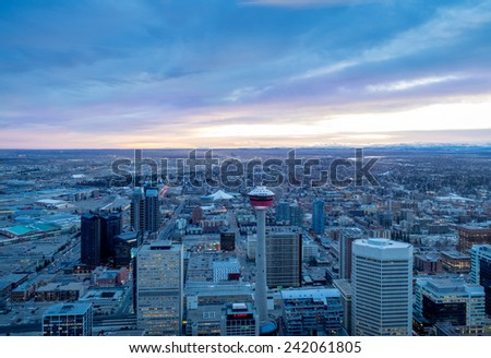 CALGARY, CANADA - DEC 22: View of Calgary Tower and various skyscrapers on December 22, 2014 in Calgary, Alberta Canada. Image is taken in the evening from the Bow Tower skygarden.  - stock photo
