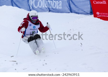 CALGARY CANADA JAN  3  2015.  FIS Freestyle Ski World Cup, Winsport, Calgary Ms. Junko Hoshino from Japan at the Mogul Free Style World Cup on race day.  - stock photo