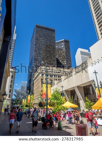 CALGARY, CANADA - JULY 1: Pedestrians walking on busy Stephen's Avenue on July 1, 2014 in Calgary, Alberta. Stephen's Avenue is a pedestrian mall in central Calgary. - stock photo