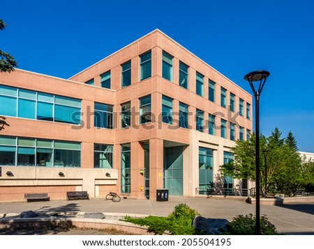 CALGARY, CANADA - JULY 13: The Professional Faculties building at the University of Calgary on July 13, 2014 in Calgary, Alberta Canada. The building house, among others, the faculty of nursing. - stock photo
