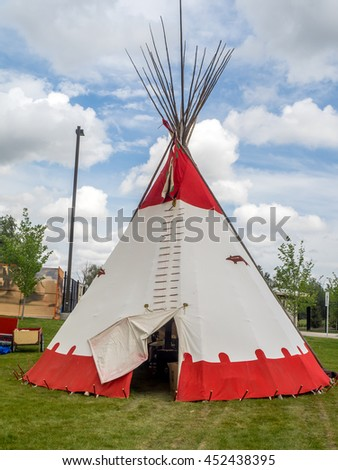 CALGARY, CANADA - JULY 9: View of Tipis  in the Indian Village at the Calgary Stampede on July 9, 2016 in Calgary, Alberta. The Indian Village represents First Nations people at the Calgary Stampede. - stock photo