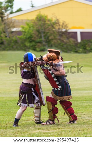 """CALGARY CANADA JUN 13 2015:  The Military Museum organized """"Summer Skirmish"""" event where an unidentified soldier is seen  in a historical Reenactment Battle. Gladiator fight. - stock photo"""