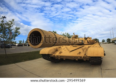 """CALGARY CANADA JUN 13 2015:  The Military Museum organized """"Summer Skirmish"""" event where an unidentified soldier is seen  in a historical Reenactment Battle. T-72 main battle tank on display. - stock photo"""