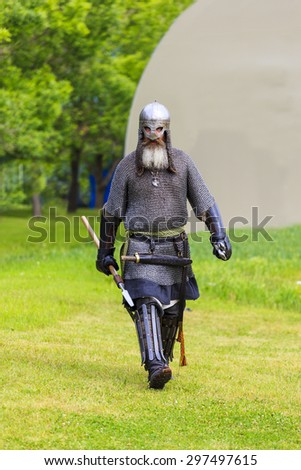 """CALGARY CANADA JUN 13 2015:  The Military Museum organized """"Summer Skirmish"""" event where an unidentified soldier is seen  in a historical Reenactment Battle.  Medieval solder in action. - stock photo"""