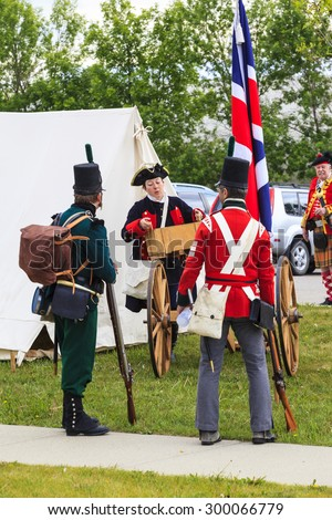 """CALGARY CANADA JUN 13 2015: The Military Museum organized """"Summer Skirmish"""" event where an unidentified soldiers are seen in a historical Reenactment Battle.  - stock photo"""