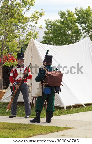 "CALGARY CANADA JUN 13 2015: The Military Museum organized ""Summer Skirmish"" event where an unidentified soldiers are seen in a historical Reenactment Battle.  - stock photo"
