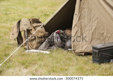"""CALGARY CANADA JUN 13 2015: The Military Museum organized """"Summer Skirmish"""" event where an unidentified soldier is seen in a historical Reenactment Battle.  Military tent and field gears. - stock photo"""