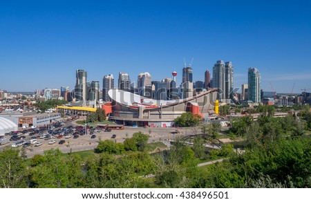 CALGARY, CANADA - JUNE 5: Calgary's skyline with the Scotiabank Saddledome in the foreground June 5, 2016 in Calgary, Alberta. The Saddledome is home to the Calgary Flames NHL club. - stock photo