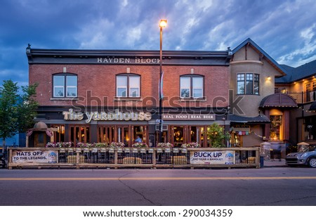 CALGARY, CANADA - JUNE 12: Facade of a pub in the Kensington area on June 12, 2015. It is known for trendy restaurants, nightlife, galleries and upscale shops, all popular with locals and tourists. - stock photo