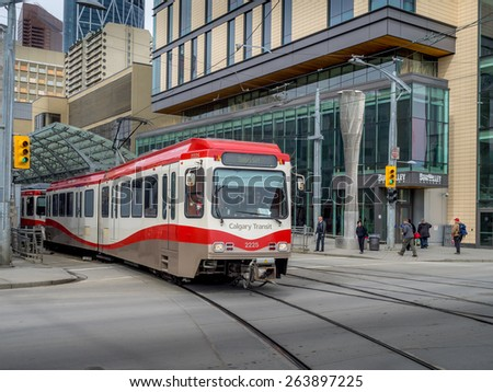CALGARY, CANADA - MAR 25: C-Train in Calgary on March 25, 2015 in Calgary, Alberta. The C-train is Calgary's main light rail transit vehicle and moves over 300,000 people a day. - stock photo