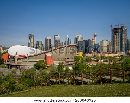 CALGARY, CANADA - MAY 24: Calgary's skyline with the Scotiabank Saddledome in the foreground May 24, 2015. The dome is home to the Calgary Flames NHL club and Lacrosse's Roughnecks. - stock photo