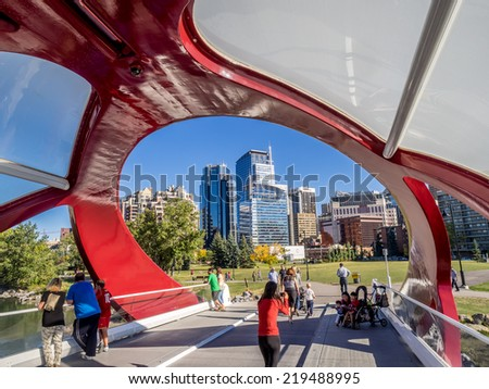 CALGARY, CANADA - SEPT 21: the Peace Bridge on September 21, 2014 in Calgary, Alberta Canada. The pedestrian bridge spans the Bow River and was designed by Santiago Calatrava.  - stock photo