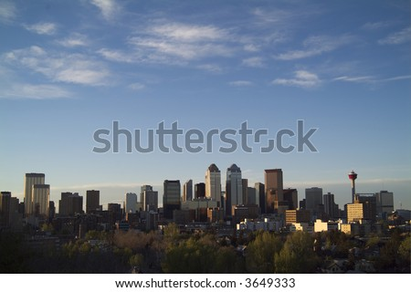 Calgary downtown skyline from south looking north at dusk - stock photo