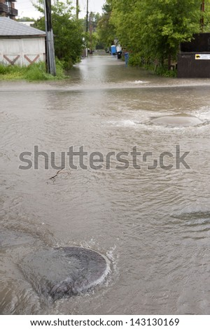 Calgary Flood 2013; Back Flowing Storm Sewers - stock photo