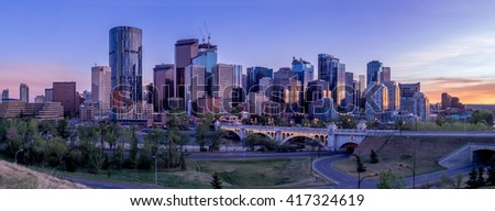 Calgary's skyline with the Bow River and Centre Street Bridge in the foreground. - stock photo