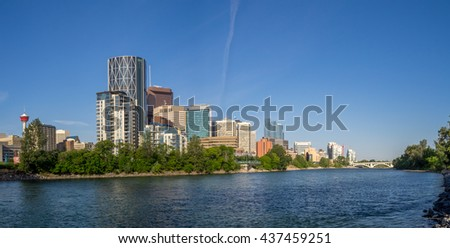 Calgary skyline along the bow river on a beautiful spring morning. - stock photo