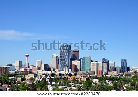 Calgary skyline with urban residential community in foreground.