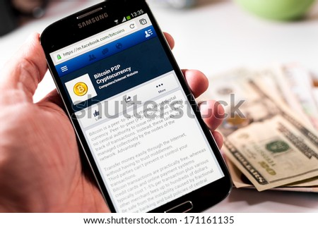 Cali, Colombia - January 11, 2014: Photo of a Samsung Galaxy S4 device, showing the official Facebook page of the Bitcoin. Bitcoin is an innovate payment network. - stock photo