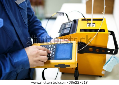 Calibration thermocouple with documenting process calibrator - stock photo