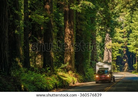 California Camper Journey. Small SUV with Compact Travel Trailer on the Redwood Highway in Northern California, USA. - stock photo