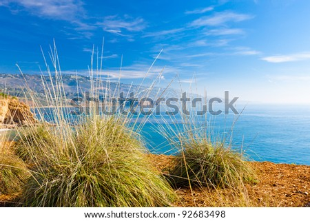 California coast landscape with cliffs, blue ocean and sky - stock photo
