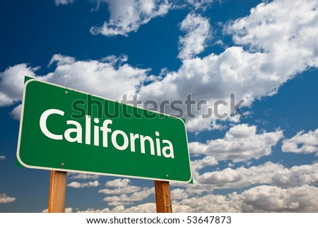 California Green Road Sign with Copy Room Over The Dramatic Clouds and Sky.