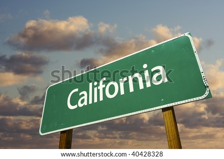 California Green Road Sign with dramatic blue sky and clouds. - stock photo