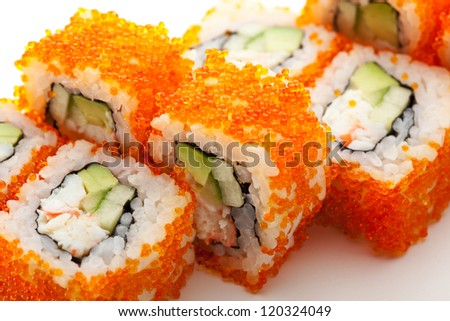 California Maki Sushi with Masago  - Roll made of Crab Meat, Avocado, Cucumber inside. Masago (smelt roe) outside - stock photo