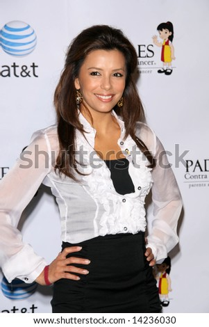 CALIFORNIA - 1 MARCH 2008: Eva Longoria accepts check from AT&T, benefitting Padres Contra El Cancer, held at the AT&T Burbank, CA Store - stock photo