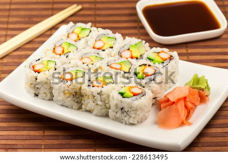 California roll maki sushi on a white plate. - stock photo