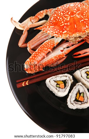 California Roll with Avocado and Salmon, Cream Cheese . on black dish with boiled crab . Japanese Traditional Cuisine - stock photo