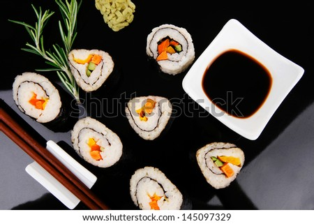 California Roll with Avocado and Salmon, Cream Cheese . on black wooden plate . Japanese Traditional Cuisine