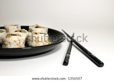 California rolls with chopsticks on white background - stock photo