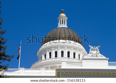 California statehouse dome showing architectural details against a blue sky background. - stock photo