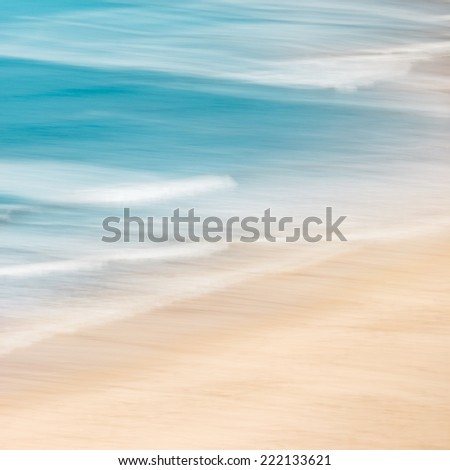 California surf and sand with panned motion blur and soft pastel colors. - stock photo