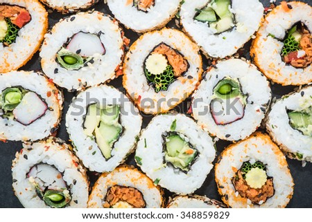 California sushi style rolls, with raw vegetables, food background - stock photo