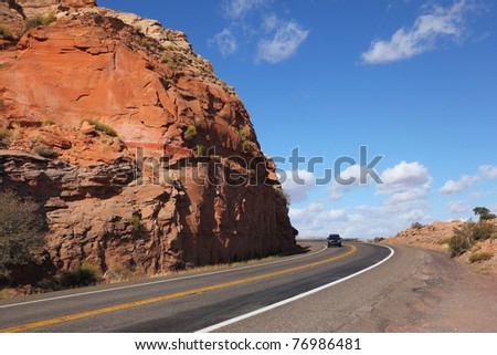 California. The Magnificent American roads in the red rock desert. Rocks and stones