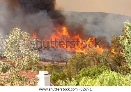 California Wildfire approaching Homes - stock photo