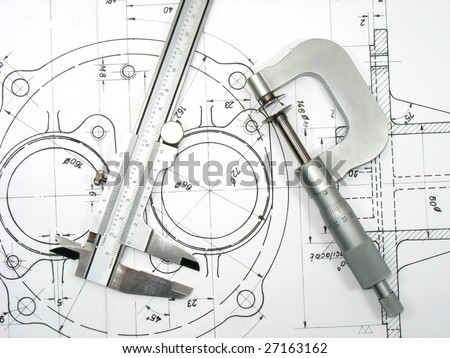 Caliper and Micrometer on technical drawings. Engineering tools on technical drawings series - stock photo